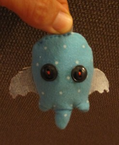 small stuffed doll. blue
